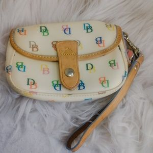 Authentic yellow Dooney & Bourke purse wristlet